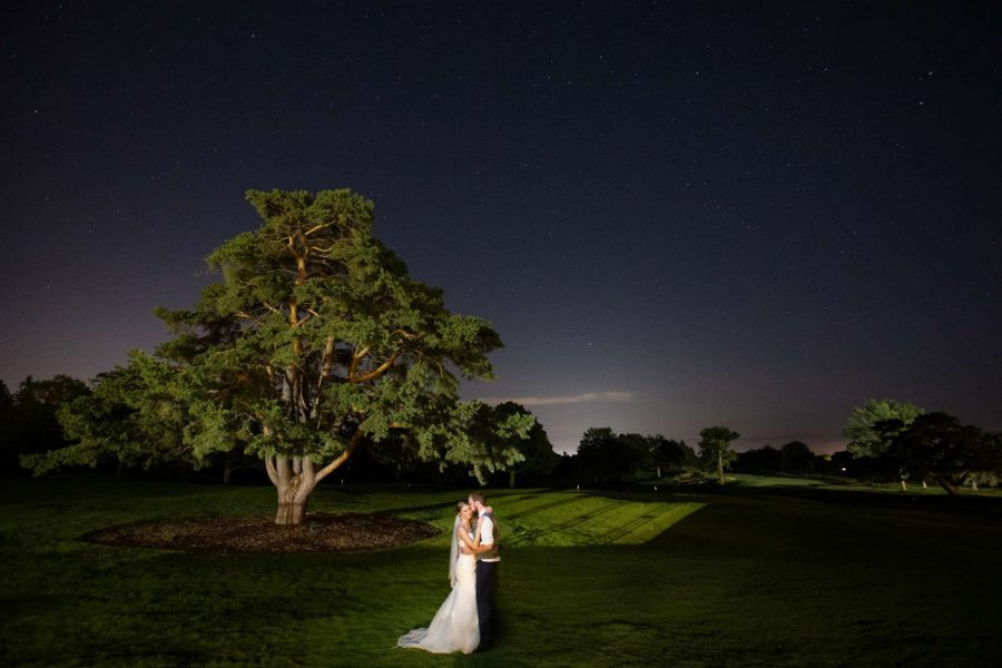 Bride and groom night shot on the grounds of the Club at Lac La Belle