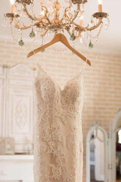 Bridal gown handing on hanger