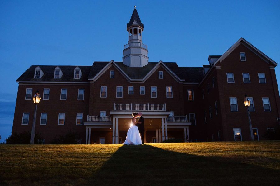 Bride and Groom embrace outside the Delafield Hotel