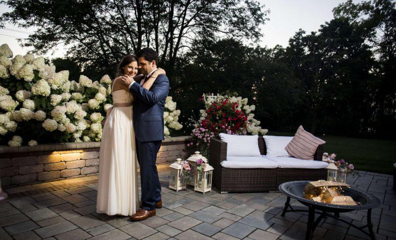 Bride and groom on the veranda at the the Ridge Hotel