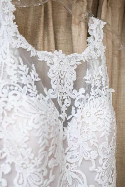 Lace wedding gown hanging up