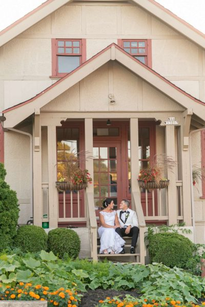 Wedding couple sitting on steps at Red Circle