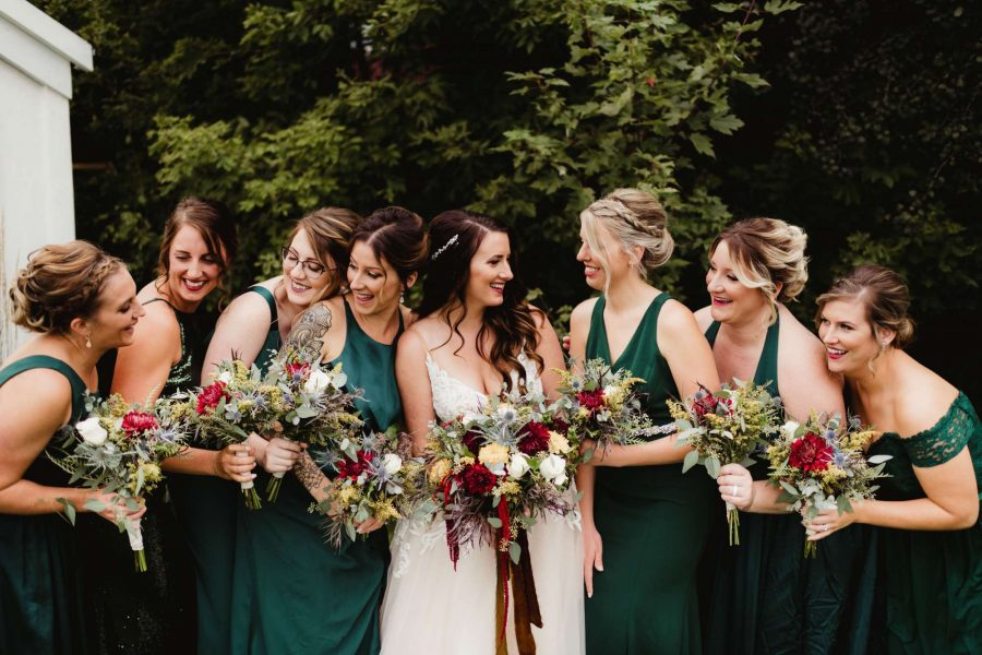 Bride and her bridesmaids with their bouquets from Alfa