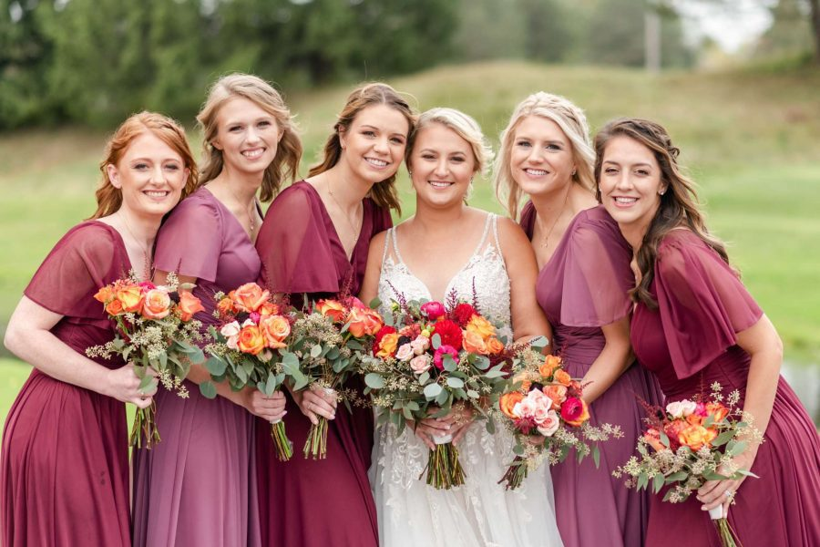 Beautiful bride with her attendants and their bouquets from Alfa Flower & Wedding Shop