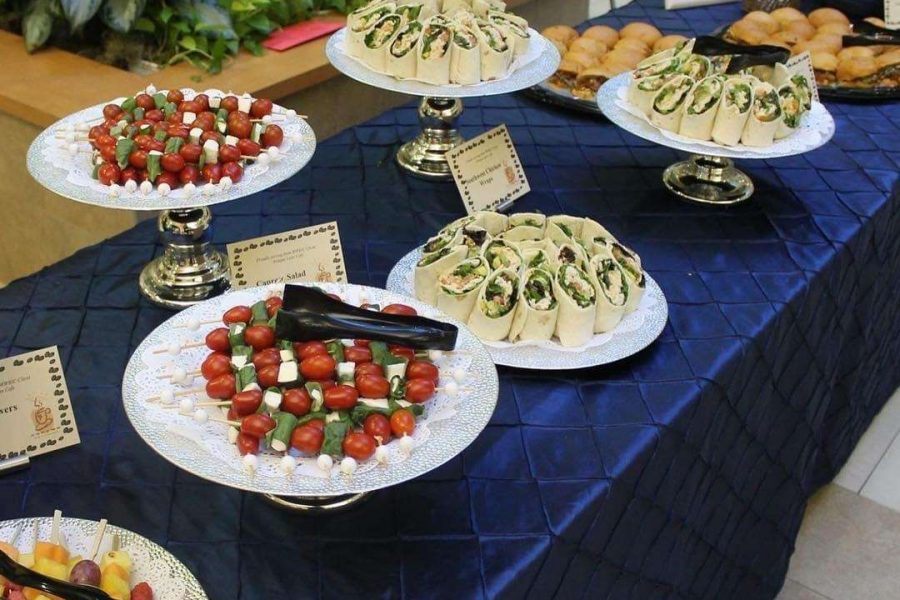 Appetizers on table with dark blue linens
