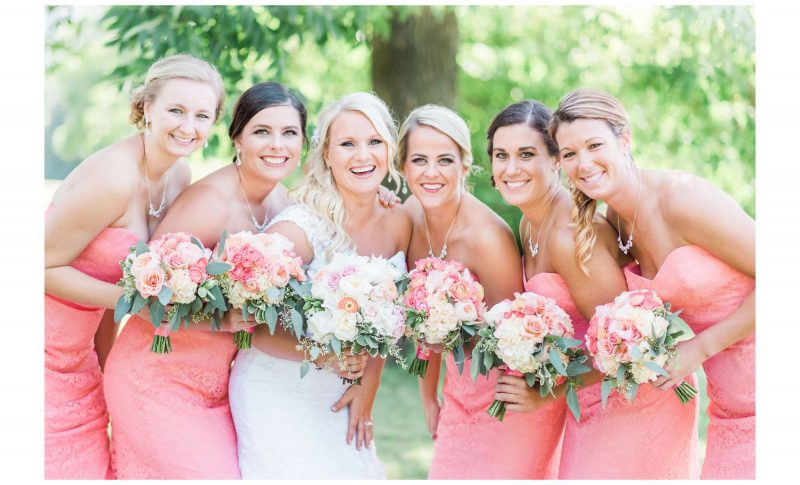 Bride with bridesmaids and floral bouquets