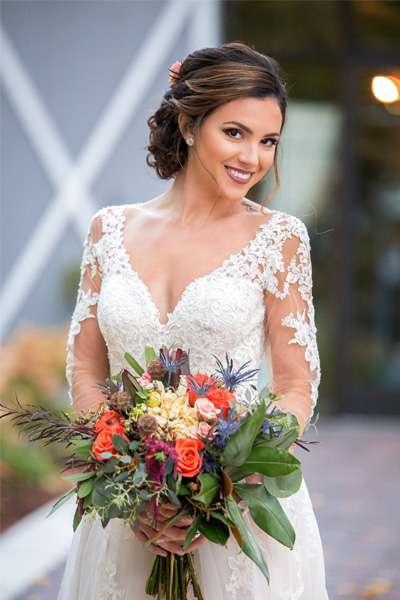 Beautiful smiling Bride with wedding bouquet