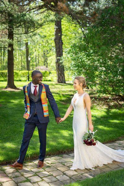 Bride and groom walk hand in hand at the Dekoven Center in Racine, WI