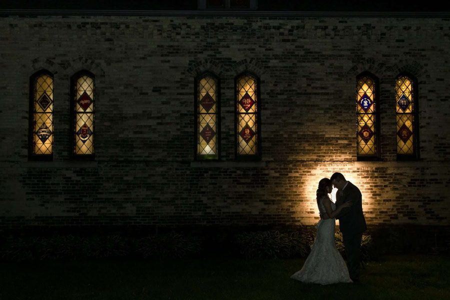 Bride and groom silhouette outside of chapel at Dekoven Center