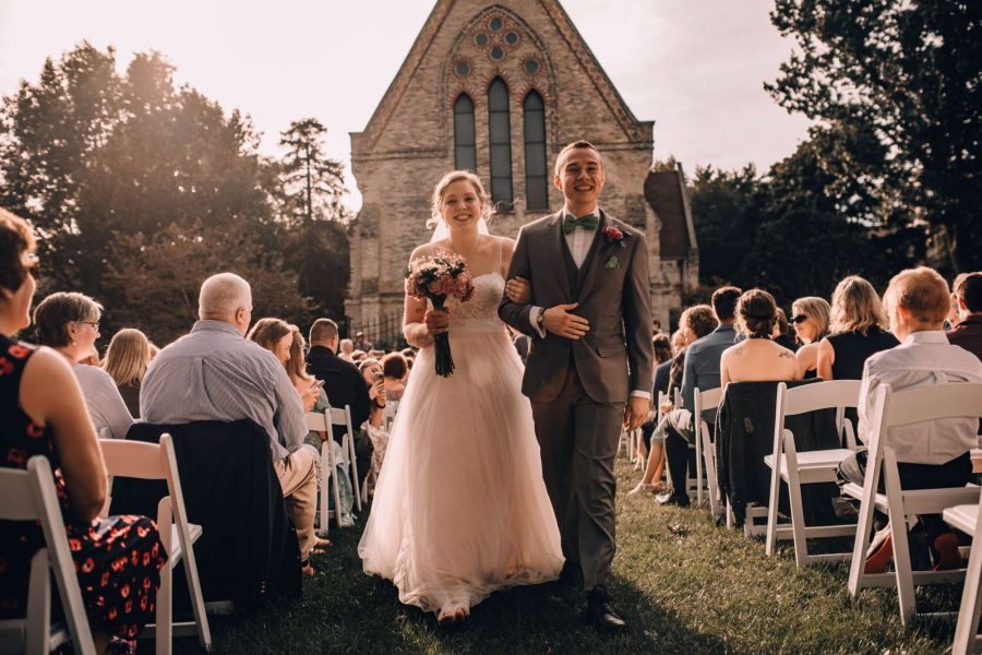 Bride and groom come back up the aisle at outdoor wedding ceremony
