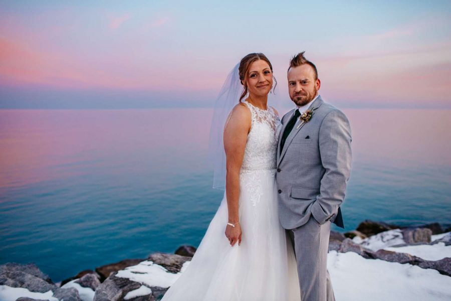 Bride and groom pose near Lake Michigan