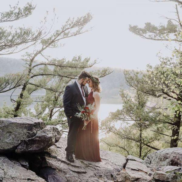 Couple pose at Devils Lake after wedding proposal