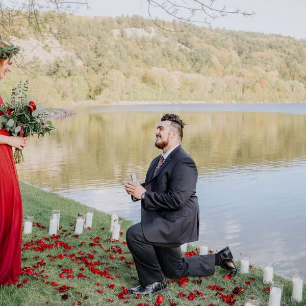 Man on one knee proposes at Devils Lake