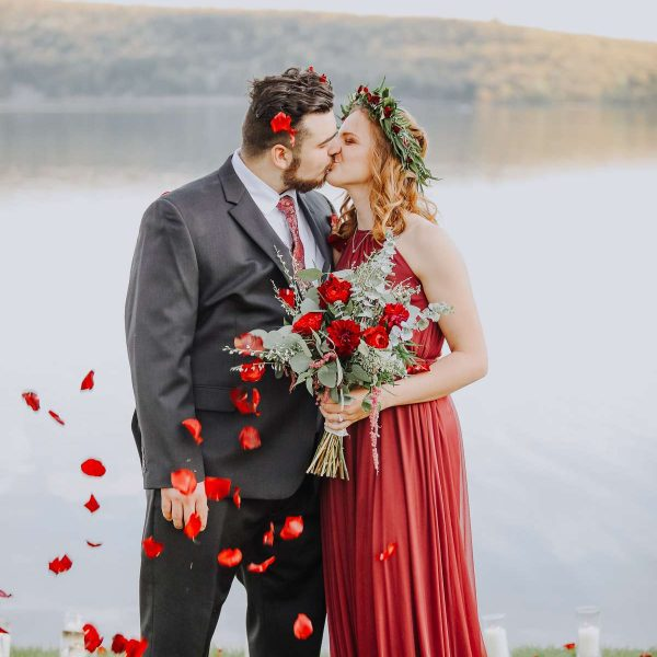 Dressed up couple pose at Devils Lake