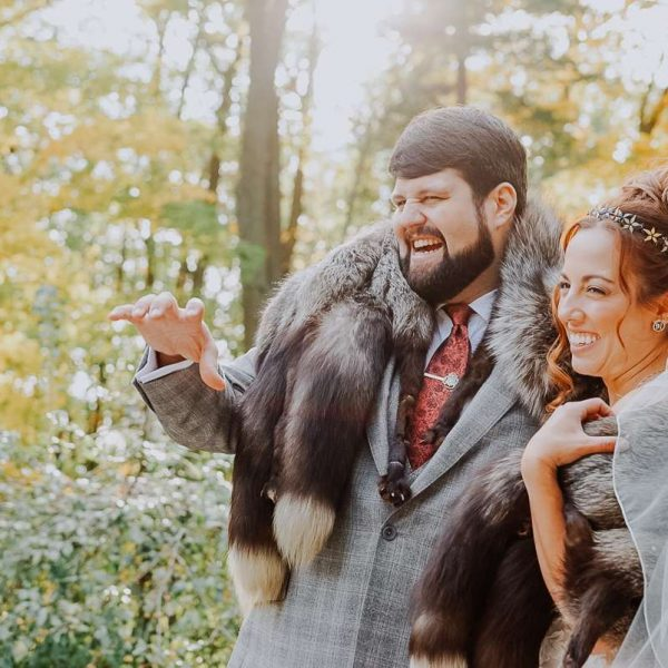 couple wears fur stoles for wedding pictures