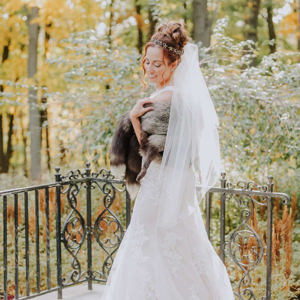 Bride poses for portrait with fur stole
