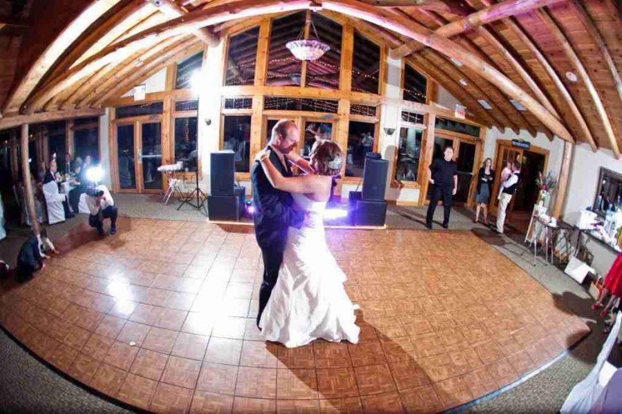 Wedding couple dancing in ballroom at Hawks View Golf Club