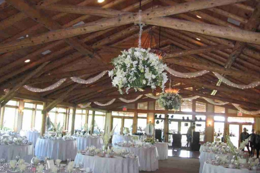 Beautifully decorating wedding with hanging flowers at Hawks View