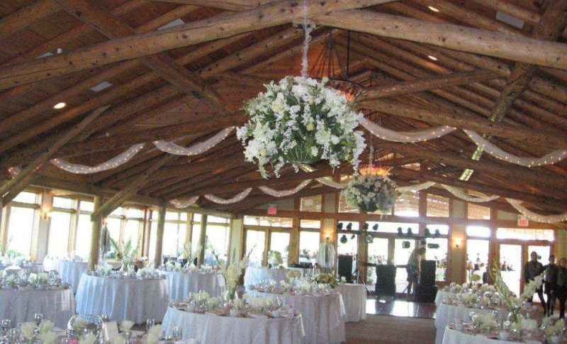 Beautiful wedding reception with hanging flowers