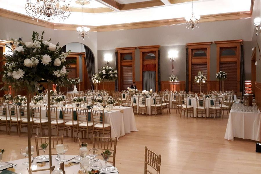 Wedding reception at the Historic Courthouse 1893 with white floral arrangments and white linens