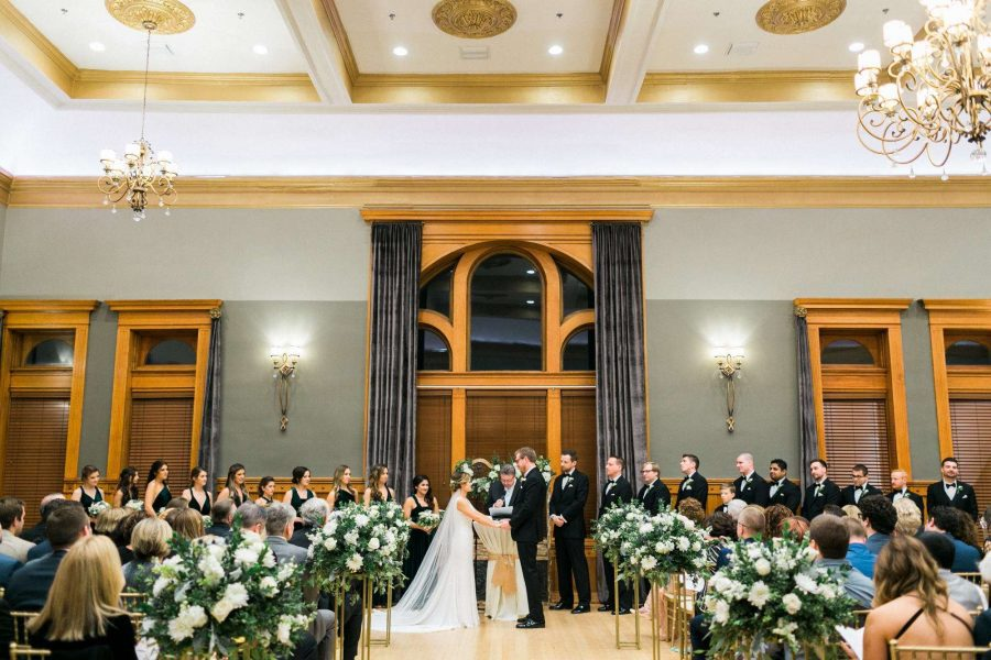 Stunning wedding ceremony with white florals at Waukesha's Historic Courthouse 1893