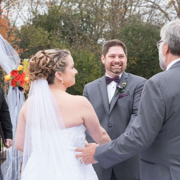 Bridal and groom wedding ceremony with officiant
