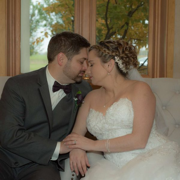 An intimate moment with the bride and groom sitting
