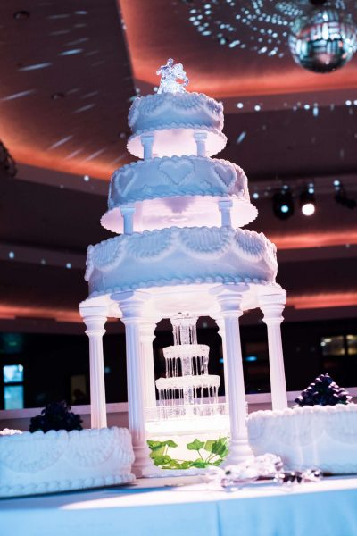 Tiered and lit wedding cake with fountain