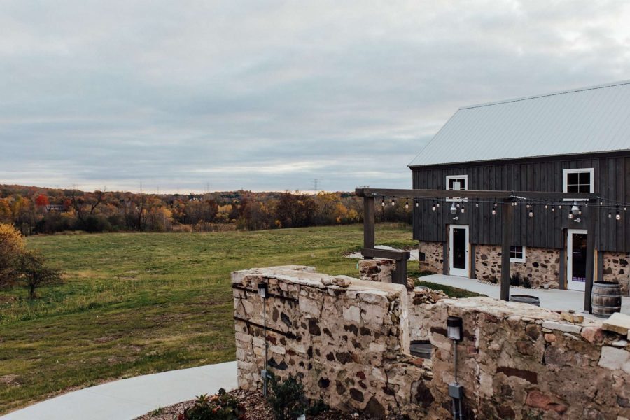 stone wall with gray barn