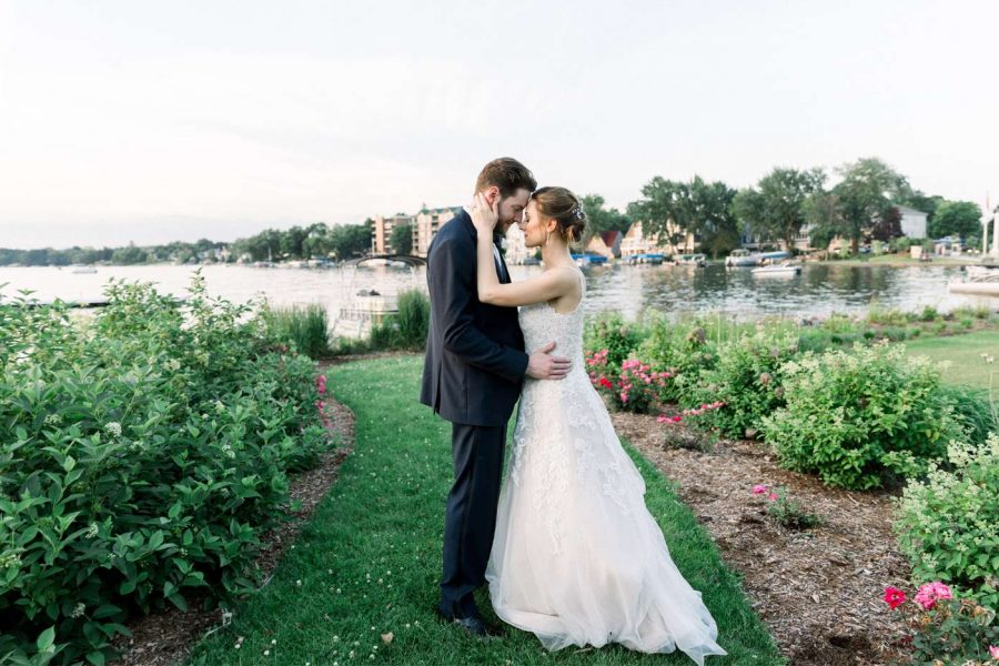 Bride and groom embrace outside of the Oconomowoc Community Center
