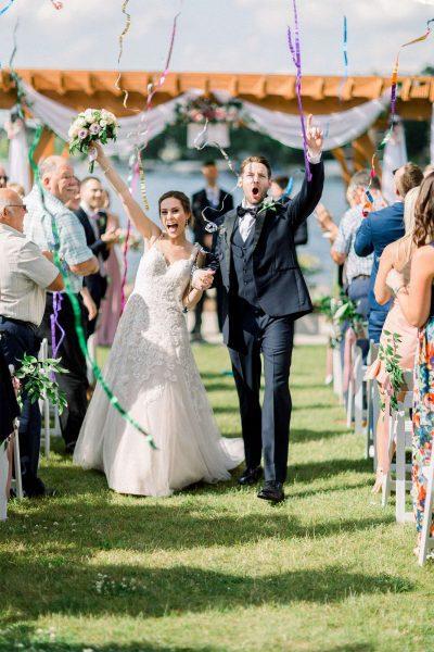 Newlyweds come back up the aisle at their Oconomowoc Community Center wedding