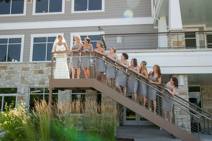Bride and wedding party on stairs at the Oconomowoc Community Center