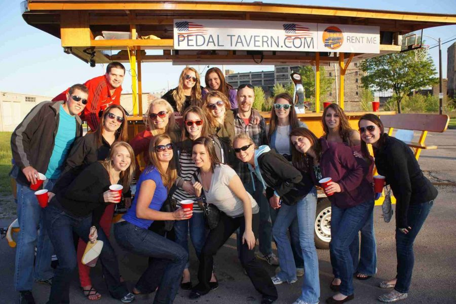 Bachelorette party group posing by the Pedal Tavern