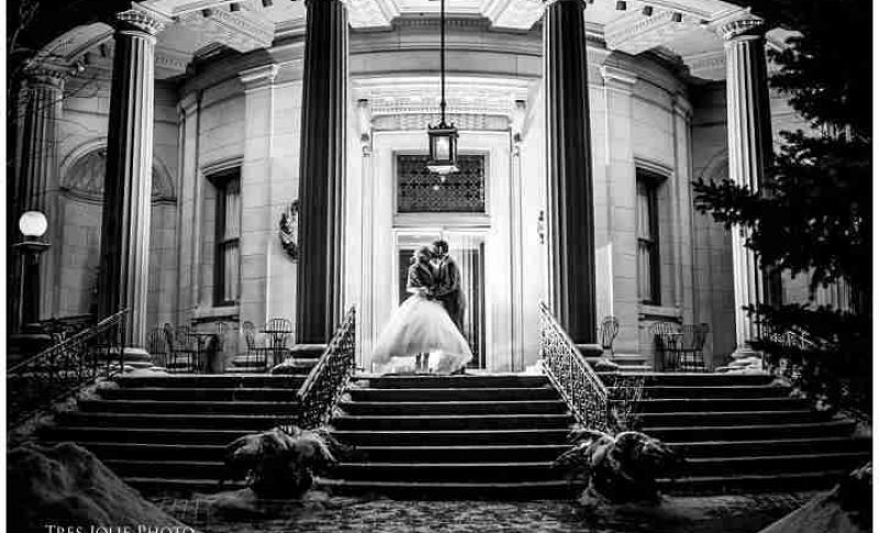 Black and White image as Bride and Groom embrace outside the The Rotunda