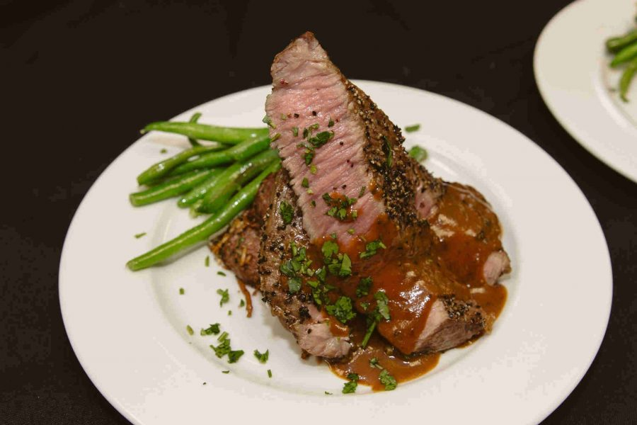 Plated Steak dinner by Saz's Catering