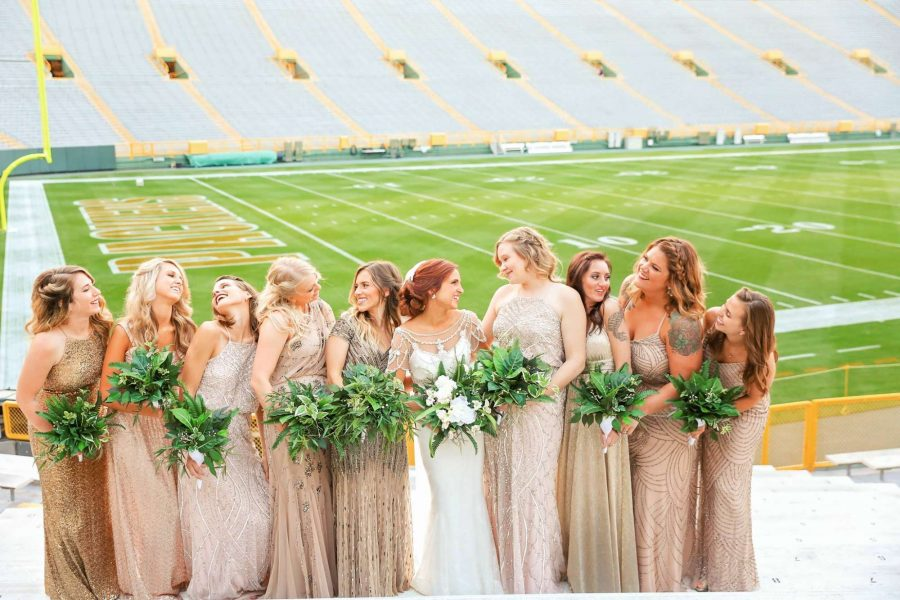 Bride and bridesmaids in Lambeau Field