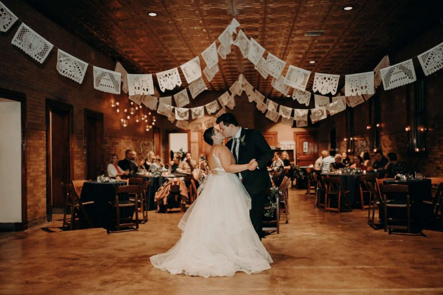 Bride and groom dance at their Story Hill Firehouse wedding reception