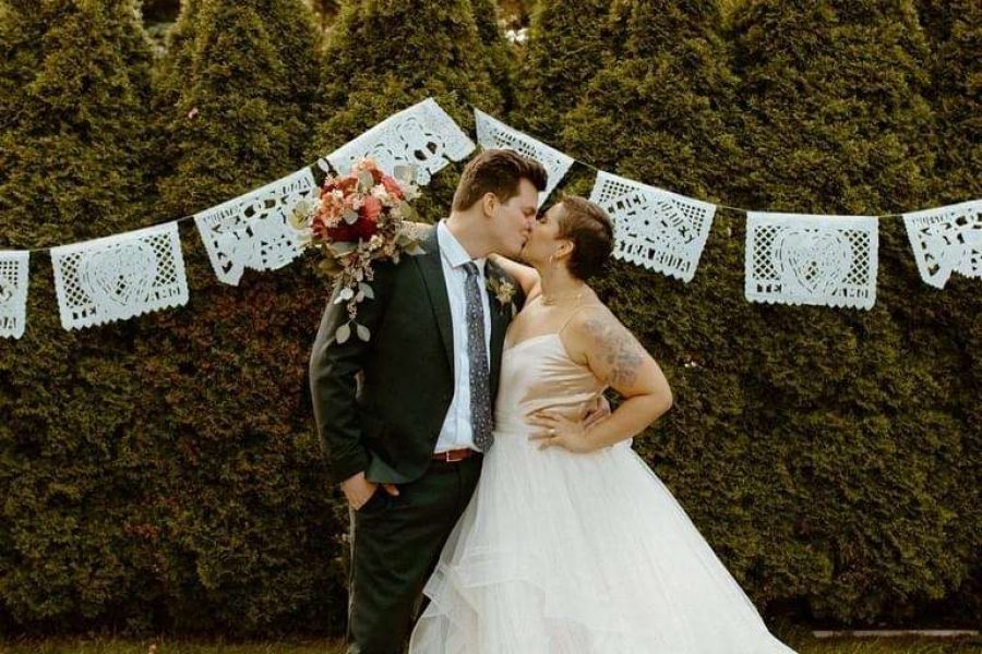 Bride and groom kiss at Story Hill Firehouse