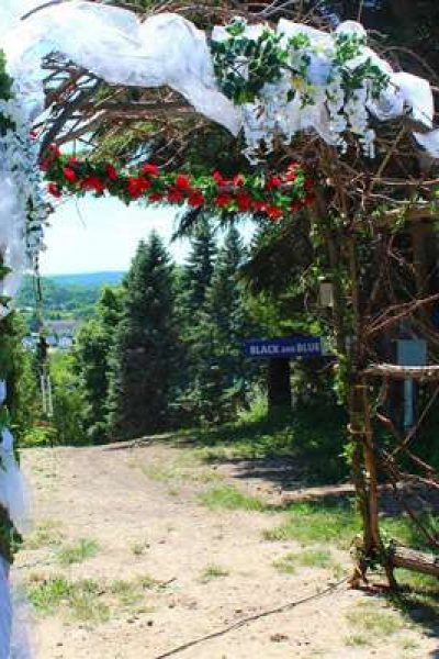 Wedding arch on top of ski hill
