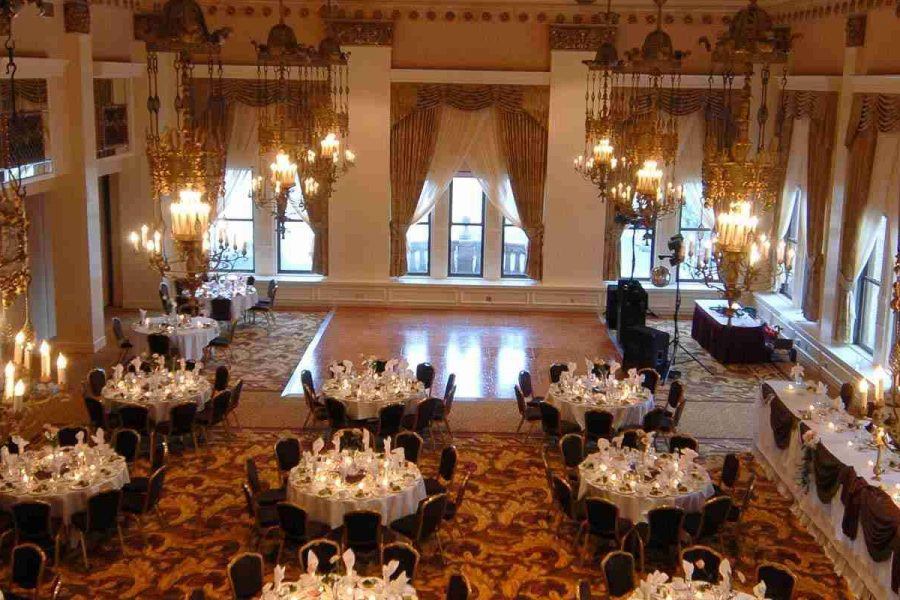 Image of decorated wedding reception looking down over whole area and crystal chandeliers