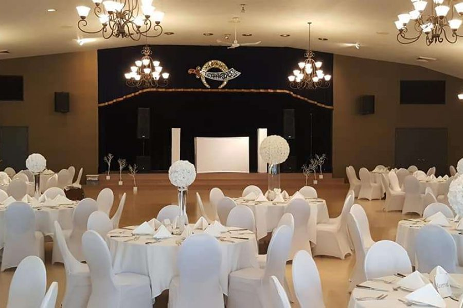 Elegant wedding reception decorated in white and black