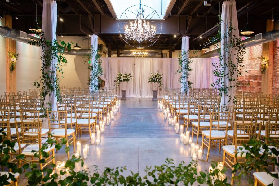 Wedding ceremony with white pipe and draping for altar and gold chiavari chairs provided by Well Dressed Tables