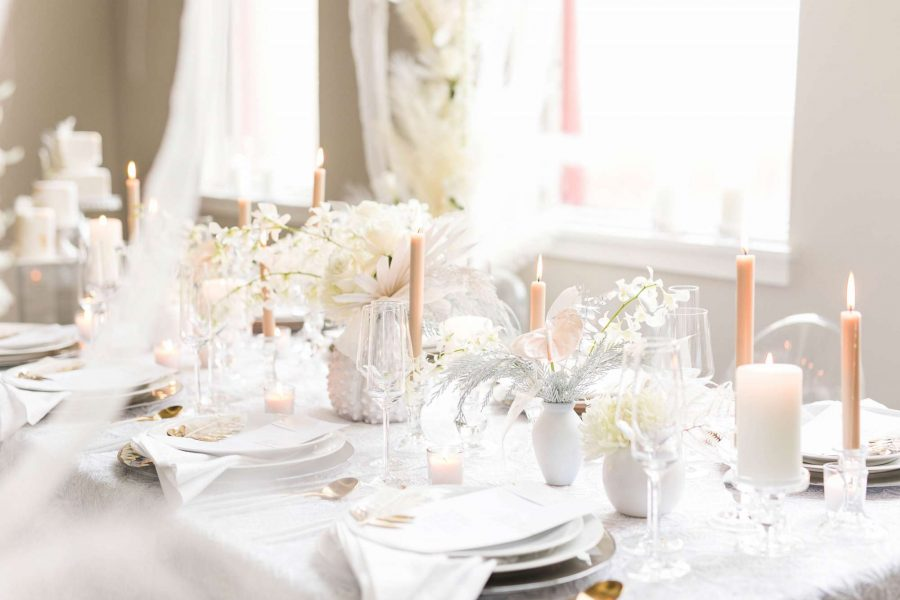 White tablescape with peach colored candles