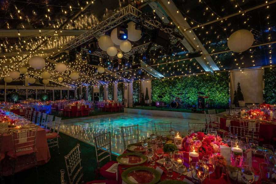 Elegant wedding inside clear tent with twinkling lights and large dance floor