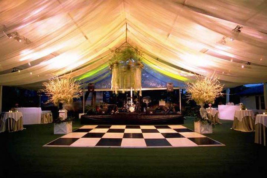 Chess board dance floor under lit tent