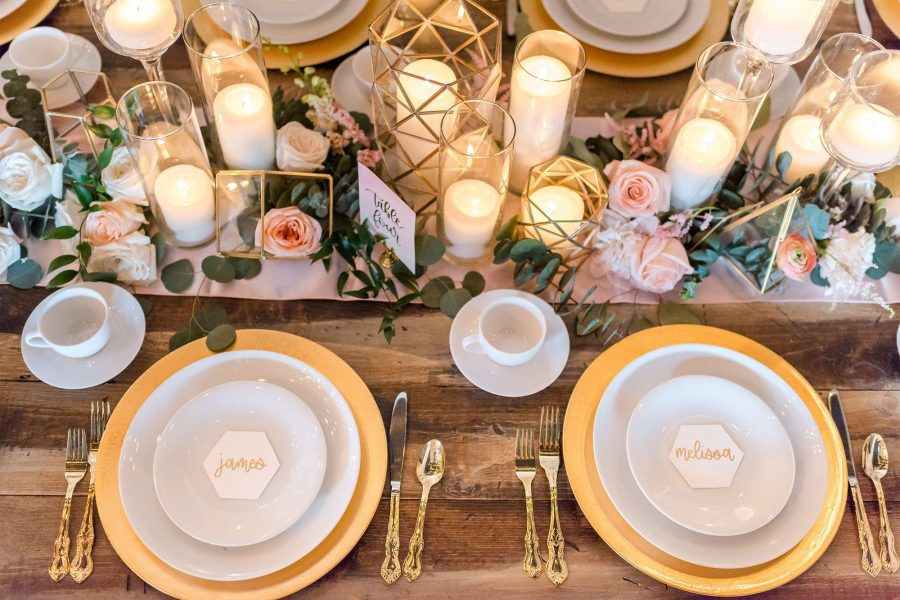 Farm house table set with gold chargers and white china