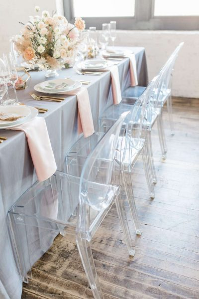 Mirage chairs at an elegant wedding tablescape by Well Dressed Tables