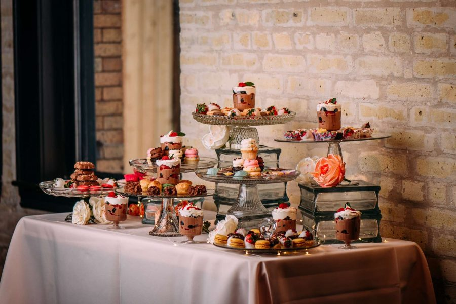 Dessert Bar set atop a rectangular table with taupe linens and clear glass serving wear
