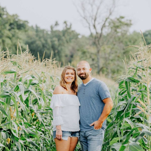 Couple pose in corn field