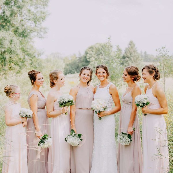 Bride and her bridesmaids with bouquets